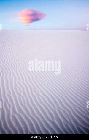 Sand dune and cloud at sunrise, White Sands National Monument, New Mexico. Stock Photo