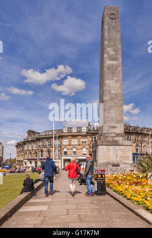Group of people walking through gardens in the centre of Harrogate, North Yorkshire, England, UK - Stock Photo