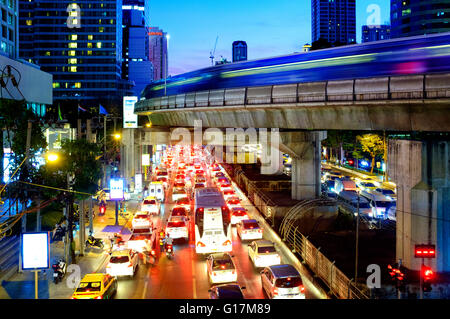 Traffic in Sathon Nuea Road, Bangkok, Thailand - Stock Photo