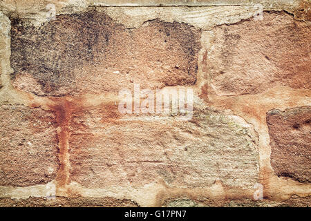 Detail of old orange brick wall. Architectural element. Bricks texture. - Stock Photo