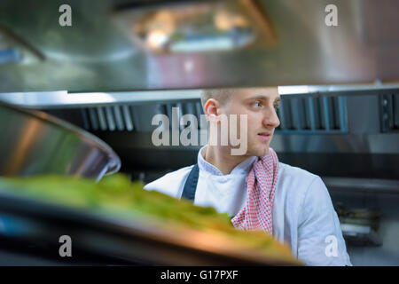 Chef in traditional Italian restaurant kitchen - Stock Photo