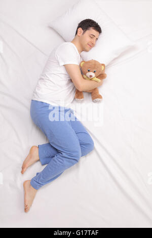 Joyful Man Sleeping And Hugging A Soft Pillow Up In Clouds