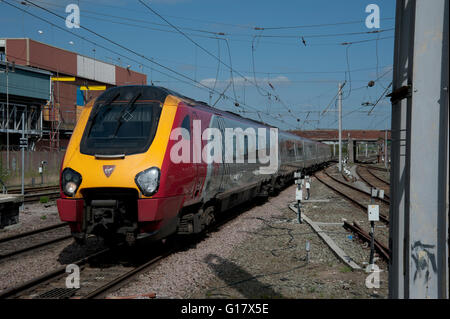 Virgin Voyager express passenger train arriving at Warrington Bank Quay station - Stock Photo