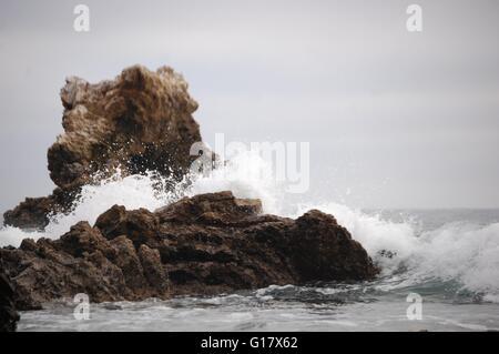 Wave crashing on a rock in Corona Del Mar - Stock Photo