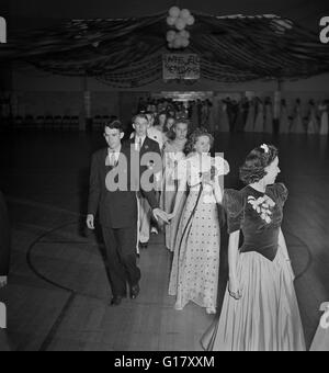 Grand March at Senior Prom Held in Gymnasium of Elementary School in Federal Housing Project, Greenbelt, Maryland, - Stock Photo