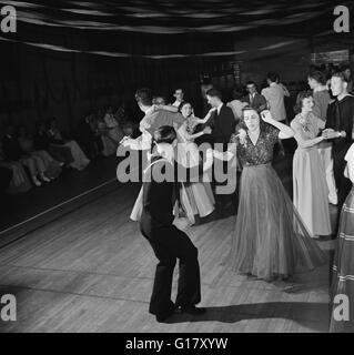 Sailor Jitterbugging at Senior Prom, Greenbelt, Maryland, USA, Marjorie Collins for Farm Security Administration, - Stock Photo