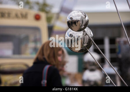 Harrogate Spring Flower Show 2016 (North Yorkshire, England) - close-up of garden ornaments (mirror spheres) with - Stock Photo