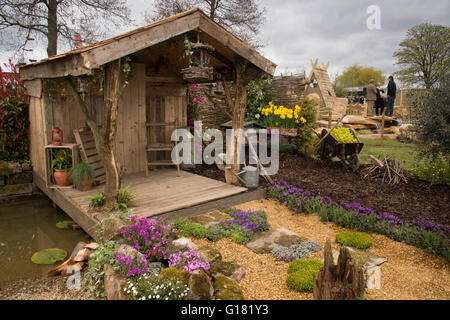 Harrogate Spring Flower Show 2016 (North Yorkshire, England) - rustic shelter, decking, pond and plants in the Wildlife - Stock Photo