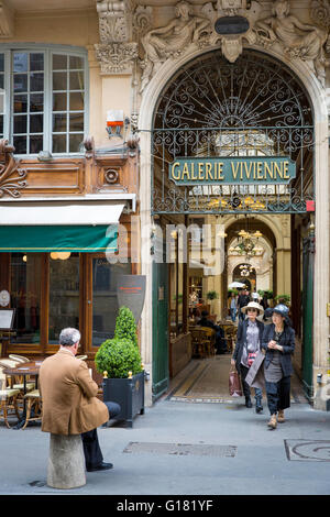 Two Asian tourists exit from Galerie Vivienne, Paris, France - Stock Photo