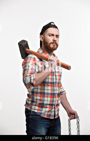 Portrait of bearded man with hammer - Stock Photo