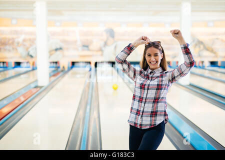 Happy woman celebrating success and achievements - Stock Photo