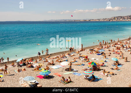 Baie Des Anges and tourists sunbathing on beach, Nice, Cote D'Azur, France - Stock Photo