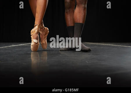Ballet dancers' feet en pointe and in second position - Stock Photo