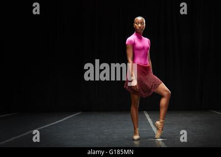 Ballet dancer with foot on tiptoe - Stock Photo