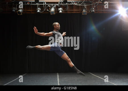 Dancer in midair pose - Stock Photo