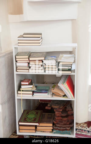 Prayer books at Nuzha Mosque (built 1937) In Jerusalem Boulevard, Jaffa, Israel - Stock Photo