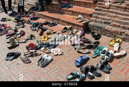 Shoes outside entrance to Buddhist temple, Wat Yai Chai Mongkhon, Ayutthaya, Thailand - Stock Photo
