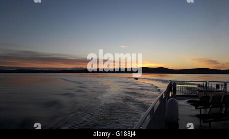 Day breaking over mainland Orkney seen from Hoy - Stock Photo