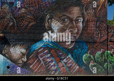 Urban art depicting Mexican rural Indian mother and daughter in the Spanish colonial city of Santiago de Queretaro, - Stock Photo