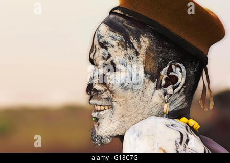 Nyangatom (Bumi) man with painted face, Omo river Valley, Ethiopia - Stock Photo