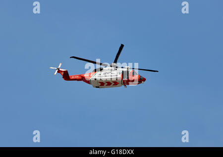 Irish coast guard rescue sikorsky s-92a helicopter on patrol search Enniscrone county sligo Ireland - Stock Photo
