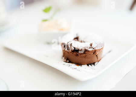 Beautiful soufflé and vanilla ice cream served in restaurant - Stock Photo