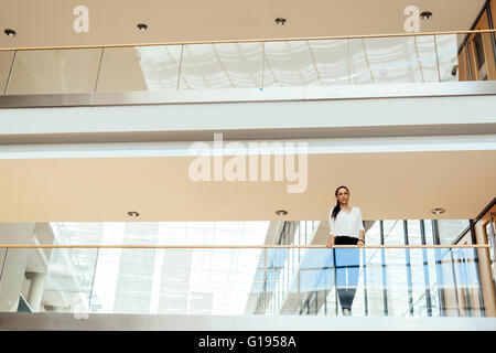 Businesswoman in a modern office building - Stock Photo