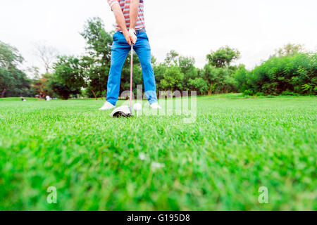 Golfer getting ready to take a shot. Wide angle photo - Stock Photo