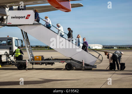 Bristol Airport, Somerset, UK. Passengers boarding an Easyjet aircraft - Stock Photo