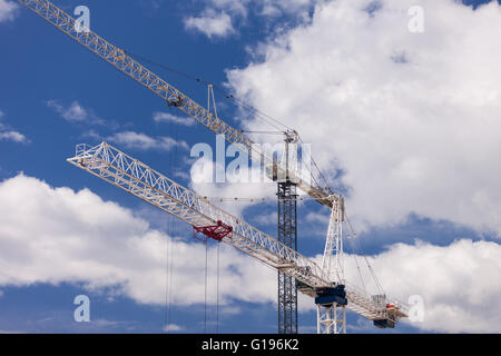Two cranes work on a constuction site in Burlington Ont, on May 9, 2016. - Stock Photo