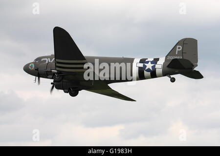 Douglas C-47A Skytrain, military version of the DC-3 Dakota,in USAAF D-Day markings making a flypast at Abingdon, - Stock Photo