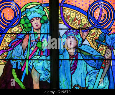 Stained Glass window in St. Vitus Cathedral, Prague, designed by Alphonse Mucha. - Stock Photo