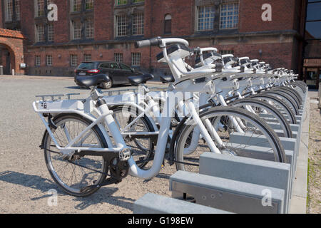 Gobike electric City Bikes at the docking station at the Black Diamond in Copenhagen. See description for tablet - Stock Photo