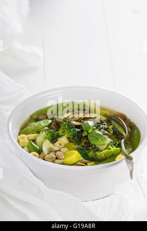 Green minestrone with vegetables - Stock Photo