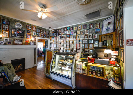 Reception, register area with famous Country Stars photo head shots on wall of Fame at the Loveless Cafe & Motel, - Stock Photo