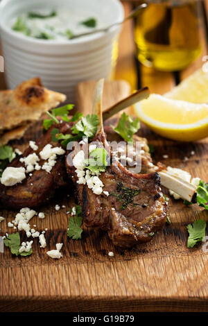 Lamb chops with herbs and feta - Stock Photo