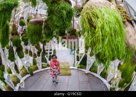 Hanging plants adorn the Times Square Electronic Garden in New York on Tuesday, May 10, 2016. A creation of New - Stock Photo