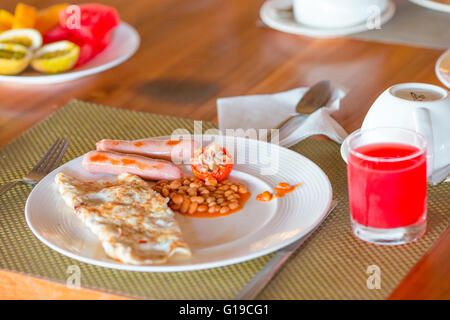 Healthy tasty breakfast on table in outdoor cafe - Stock Photo