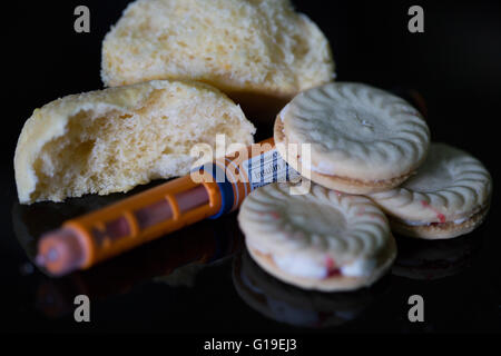 Insulin pen with blood sugar meter & test strip,used in the treatment of Diabetes mellitus.High carbohydrate foods - Stock Photo