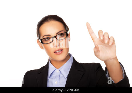 Businesswoman using a virtual interface - Stock Photo