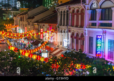 High view of street stalls with different chinese new year decoration and food in Chinatown, Singapore - Stock Photo