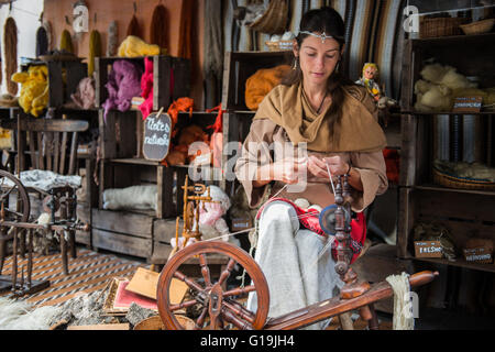 Woman Spinner working on a stand outdoors - Stock Photo