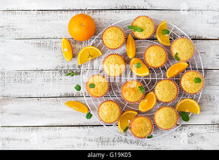 Tasty muffins with oranges and mint. Top view - Stock Photo