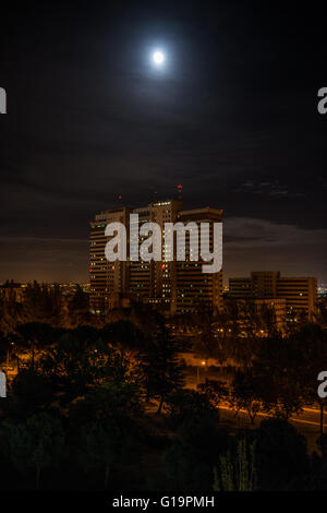 Night shot of an hospital building under the moon light. - Stock Photo