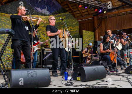 Oysterband jam with Chinese group Hangai, Canmore Folk Music Festival, Canmore, Alberta, Canada - Stock Photo