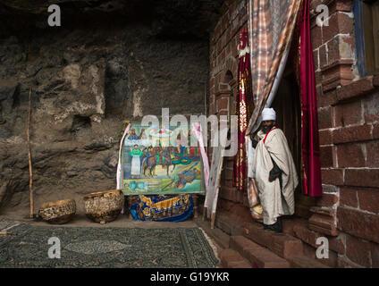 Ethiopian orthodox priest in nakuto lab rock church, Amhara region, Lalibela, Ethiopia - Stock Photo