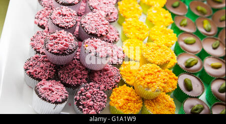 Colorful chocolate candies on a market counter, close-up photo with selective focus