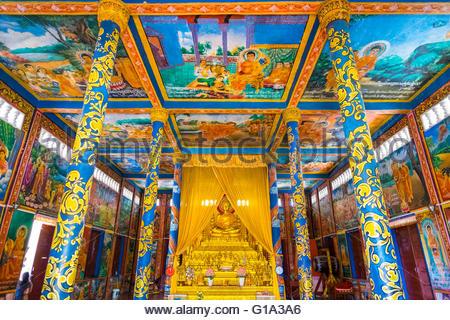 Colorful murals and altar inside Wat Krom, Sihanoukville, Preah Sihanouk Province, Cambodia - Stock Photo
