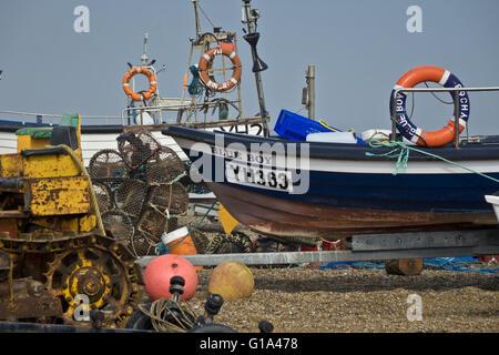 small fishing boats on shingle beach - Stock Photo