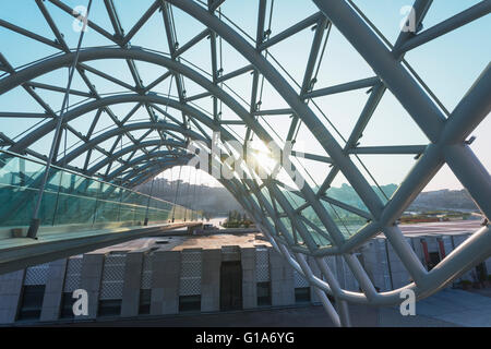 Eurasia, Caucasus region, Georgia, Tbilisi, Bridge of Peace on Mtkvari river - Stock Photo